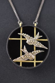 Shakudo, 18ct gold with sterling silver and marcasite swallows.