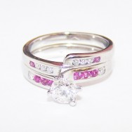 Platinum, diamonds and pink sapphires.