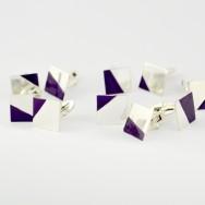 Sterling silver cufflinks with cadbury purple highlights.