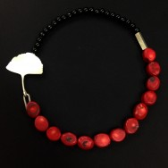 Dyed coral and black onyx with sterling silver features.
