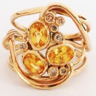 Yellow sapphires and Kimberley diamonds in gold.