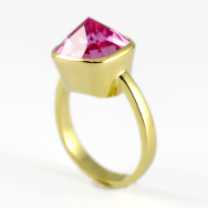 Pink created gilson sapphire in 9ct gold.