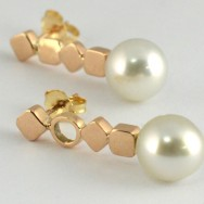 Cygnet Bay silver pearl earrings on pink gold