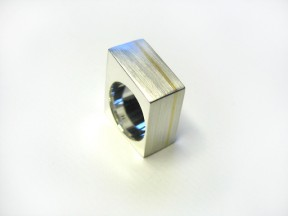 Sterling silver with 18ct yellow gold inlay.