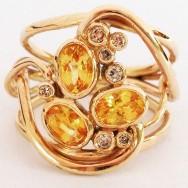 Yellow sapphires and Kimberley diamonds in gold.