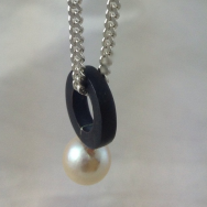 South sea pearl with shakudo on a sterling silver chain with gold fob.