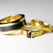 24ct gold, flawless ruby, reclaimed diamonds and client's original wedding band. Shakudo, palladium and client's original wedding band.