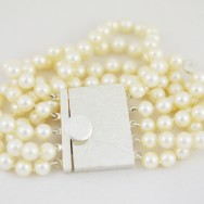 Textured sterling silver box clasp on pearls.